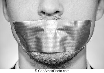 Photo of a young man with sellotape covering his mouth