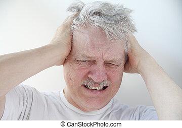 man with severe headache pain
