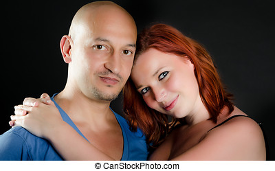 Man with shaved head a girl with red hair
