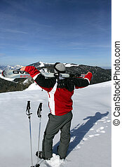 Man with skis on his back