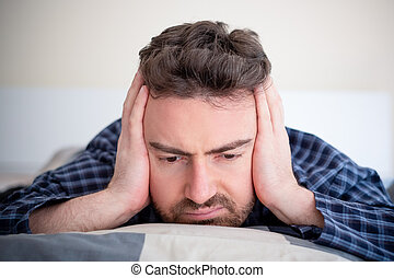Man with sleep problem in his bed at home