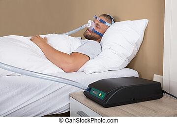 Man With Sleeping Apnea And CPAP Machine