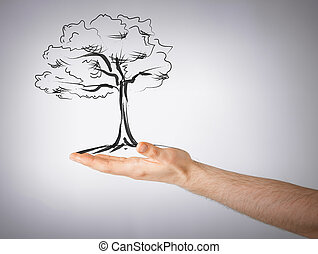 man with small tree in his hand - environment, ecology and...