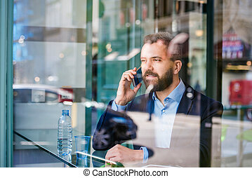 Man with smart phone - Double exposure of a handsome young ...