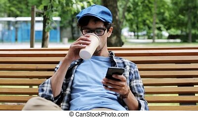 man with smartphone drinking coffee on city street 16