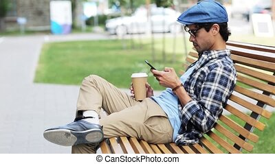man with smartphone drinking coffee on city street 36