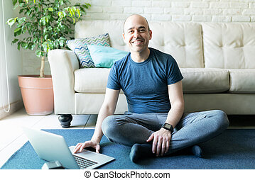 Man with smartwatch exercising at home