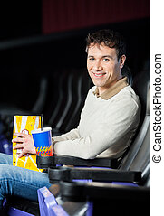 Man With Snacks At Cinema Theater