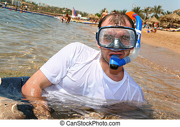 Man with snorkel in mouth