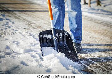 Man with snow shovel