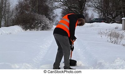 Man with snow shovel on the snovy