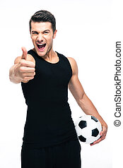 Man with soccer ball showing thumb up sign