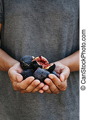 man with some figs in his hands
