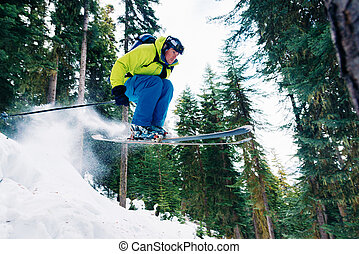 man with special ski equipment is riding and jumping very...