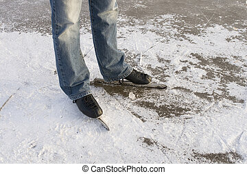 Man with speed ice skates on ice