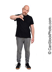 man with sportswear thumb down  on white background