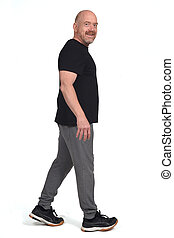 man with sportswear walking on a white background