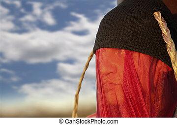 Man with strange headdress and veil