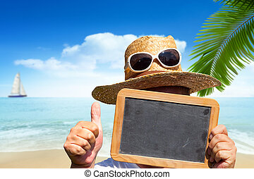 Man with straw hat and sunglasses holds blank slate blackboard