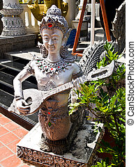 Man with Stringed instruments statue in Thai molding art
