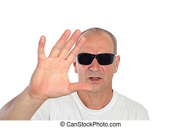 man with sunglasses making a sign
