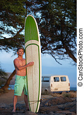 Man with Surfboard and Van