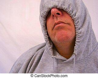 Man with sweatshirt hood over face