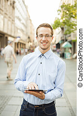 Man With Tablet Computer on street