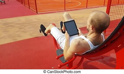 Man with tablet computer on workout