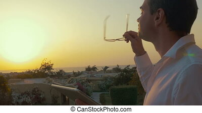 Man with Tablet PC at Sunset