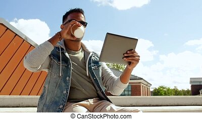 man with tablet pc having video call on roof top