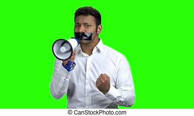 Man with taped mouth trying to speak. Young businessman with...