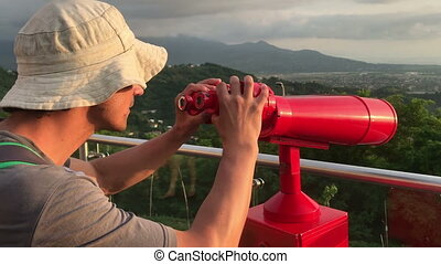 man with telescope in touristic place video