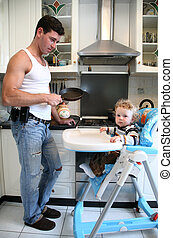 man with the child on the kitchen