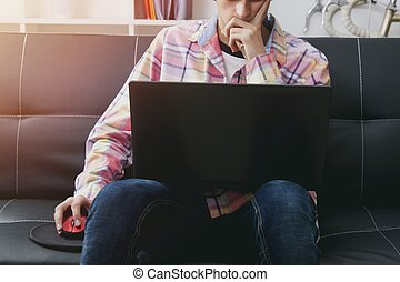 man with the computer in the living room of home