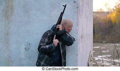 Man with the gun hiding behind the wall - Man with AK hiding...