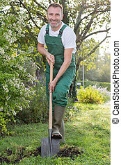 man with the shovel in the garden