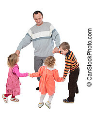 Man with three kids dancing