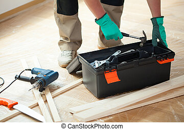 Man with toolbox during renovation at home