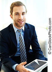 Man with touchpad - Portrait of attractive businessman with...