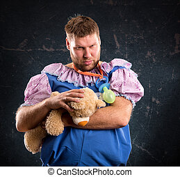 Man with toy bear