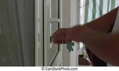 Man with travel bag unlocking the front door