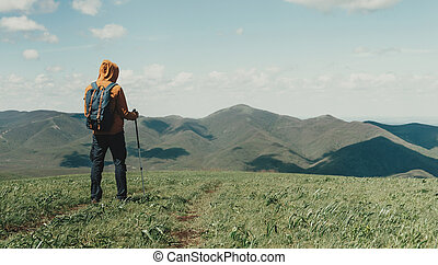 Man with trekking poles