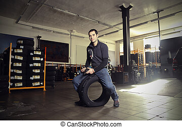 Man with tyre