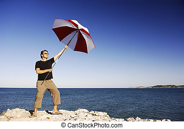 Man With Umbrella At The Beach