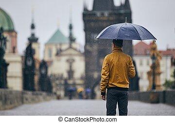 Man with umbrella in heavy rain