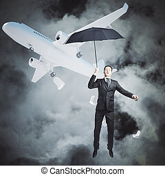 Man with umbrella in sky