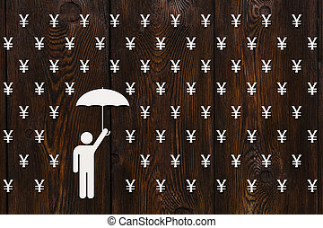 Man with umbrella standing in rain of yen, money concept