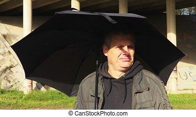 Man with umbrella sunny day