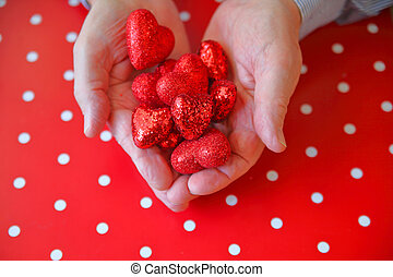 Man with Valentine hearts on polka dot background